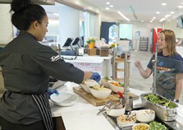 Dana Chef serving food at cafeteria